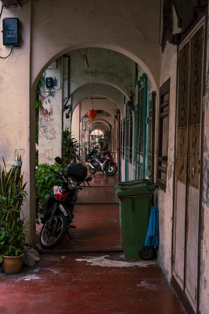 A cute lane with motorbikes parked