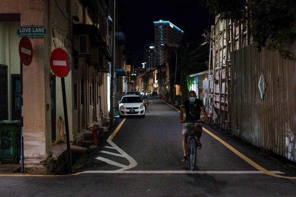 A lone rider on a bicycle near Love Lane in George Town