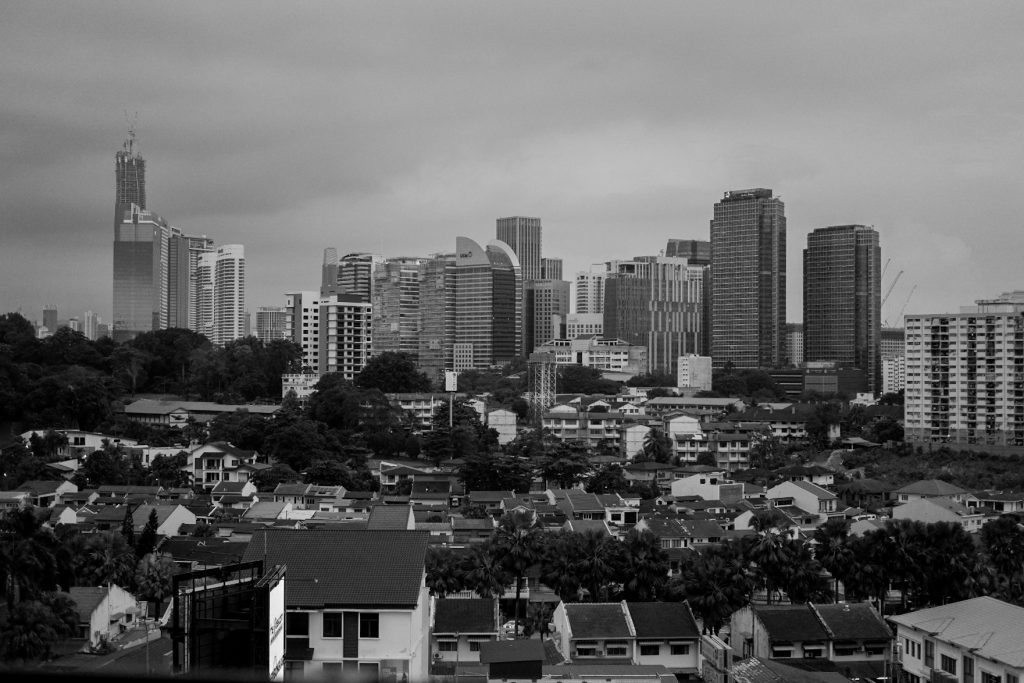 Black and white photo of a cityskape from a roof top bar