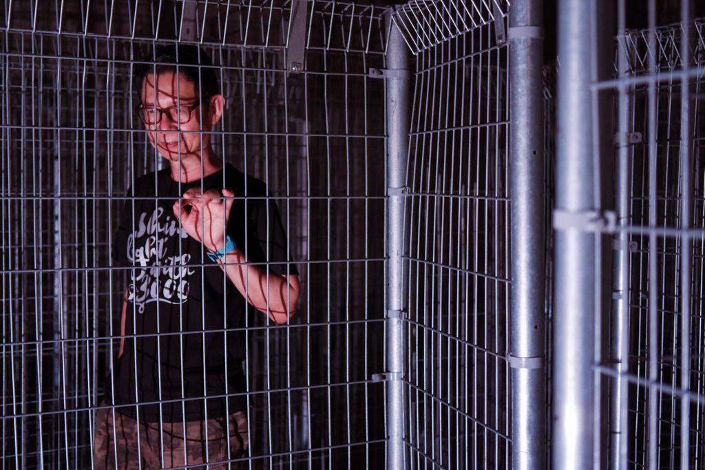 Artist Andrew Pok posing in this maze installation