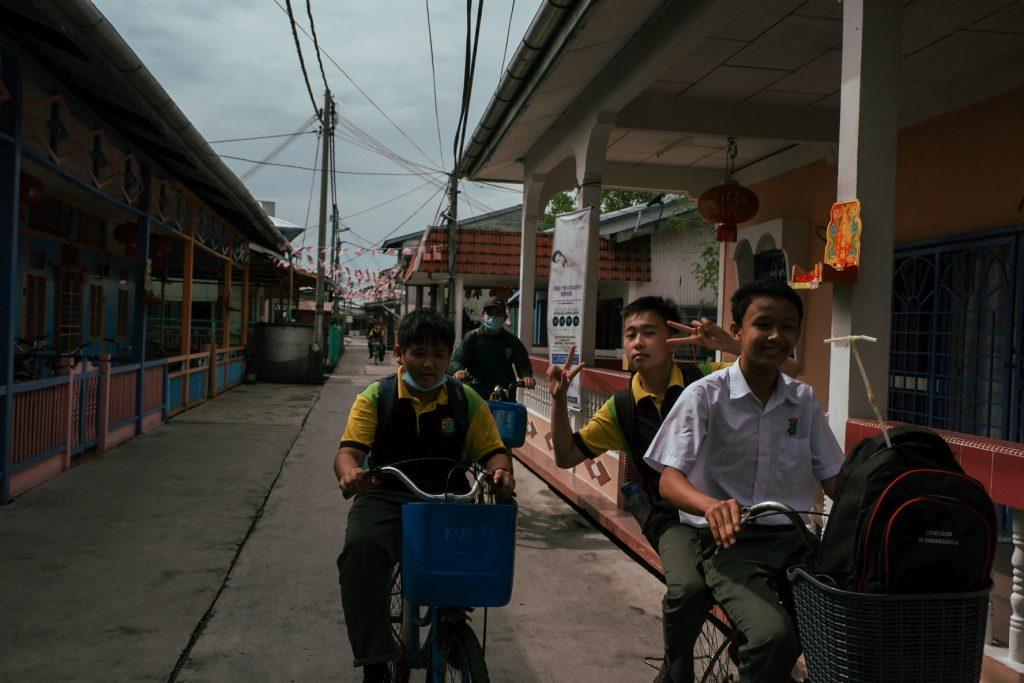 Kids on bicycles greeting me
