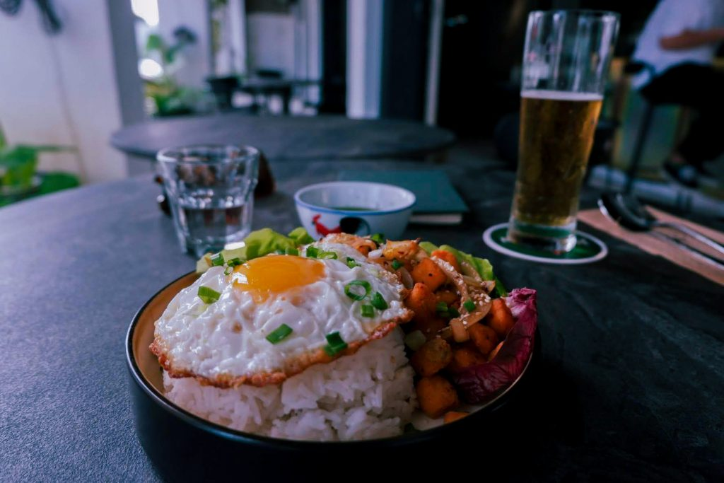 A meal with rice and beer on a table
