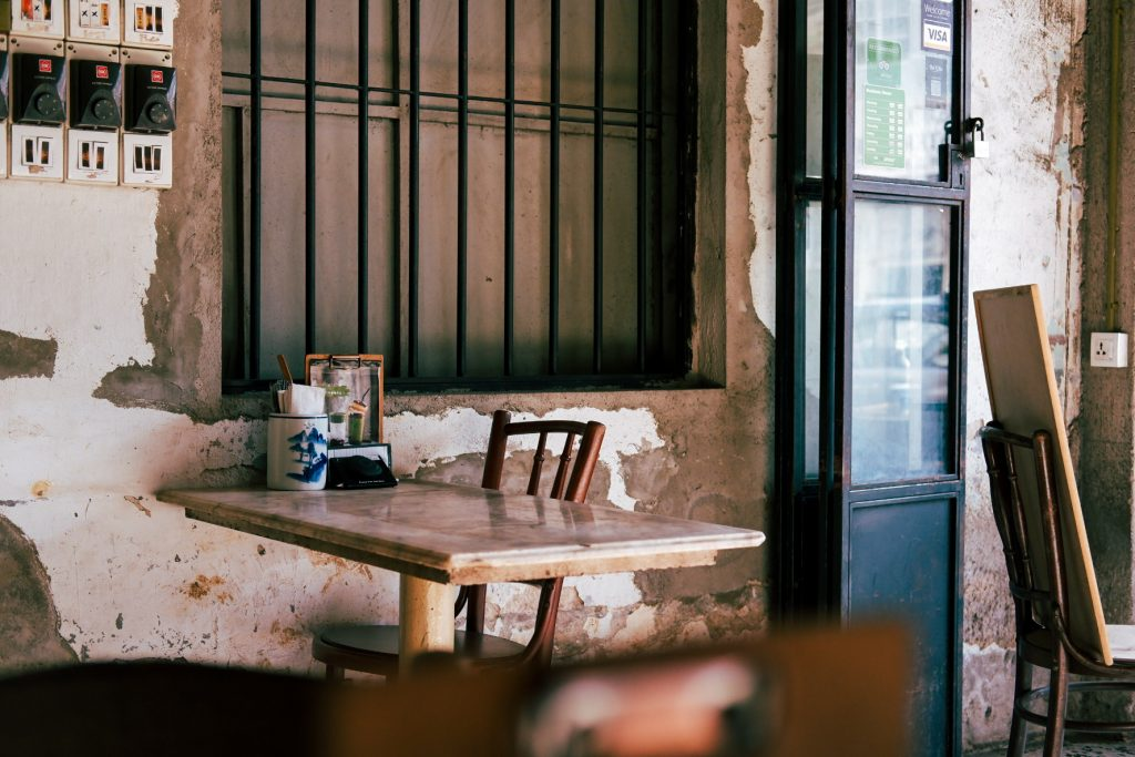 A chair and a table at a rustic style cafe