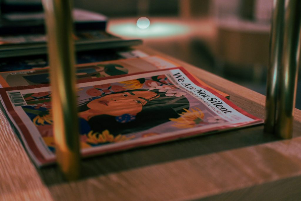 Close up of a front page of a magazine lain on a shelf at a café