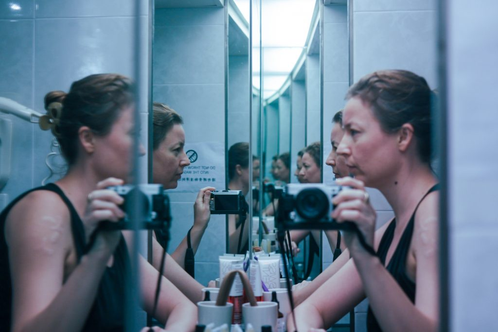 Portrait of myself talking to a mirror