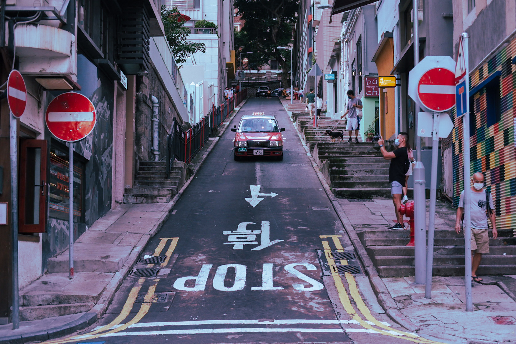 Taxi moving down a narrow steep lane in Hong Kong