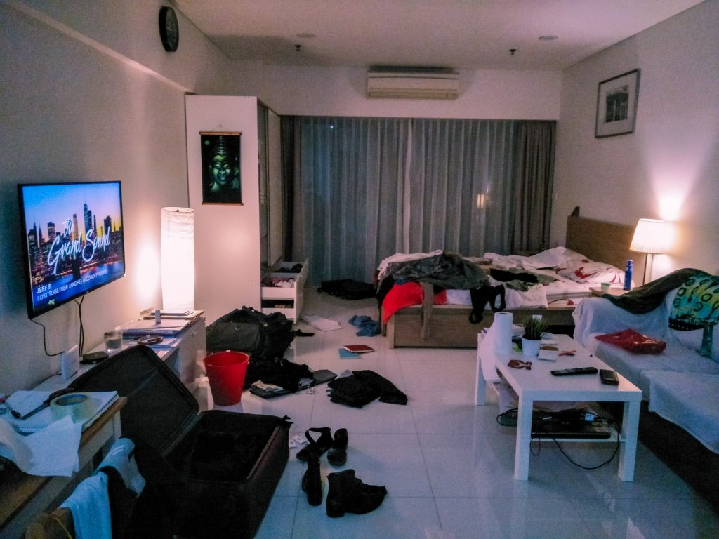 Mess in a studio flat due to packing before leaving the country